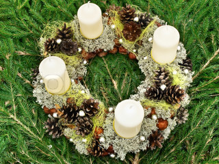 Christmas handmade garland with candles and natural decorations at gren fir