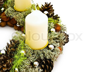 Part of Christmas handmade garland with candles and natural decorations against the white background