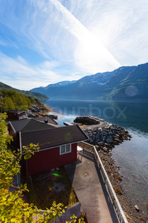 Rorbuer traditional norwegian red wooden house to stand at the lakeside and mountains in the - The house on the rock the ultimate refuge in a norwegian fjord ...