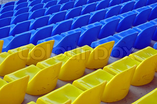 Blue and yellow empty stadium seats