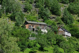 Traditional wooden houses on hillside near Geiranger, Norway