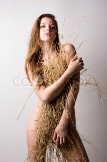 young beautiful naked woman with straw wisp