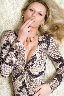 Smoking young pretty blonde on the carpet