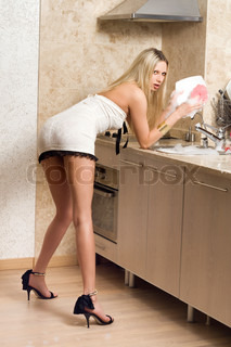Sexy woman washing up and posing