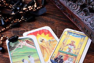 Cards tarot with a casket for their storage and a magic beads.
