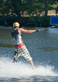Young man wakeboarding on the lake