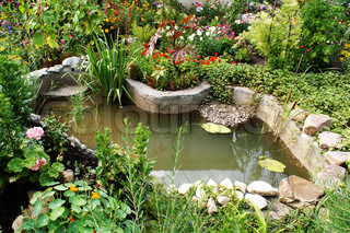 green; pond; stream; water; stones;