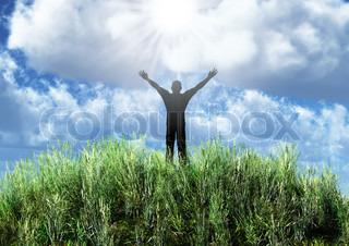 Silhouette of the man on an abstract meadow. On a background of the dark blue sky