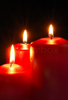 Candle. A burning flame of a candle of red color