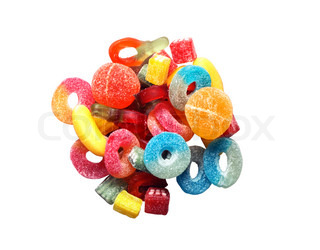 Lot of multicolored sweet candy and fruit jelly isolated on white with clipping path