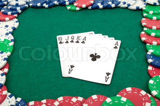royal flush and chips on a green table