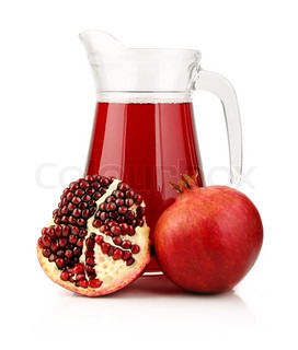 Glass of  pomegranate juice with fruits isolated on white background