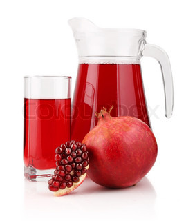 Jug and glass of  pomegranate juice with fruits isolated on white background