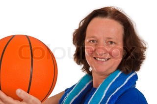 Middle aged woman with basketball on white background