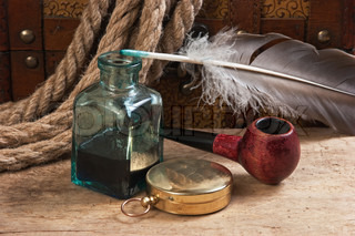 old tobacco pipe and inkwell, still life