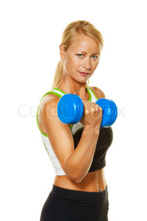 A young woman with free weights while training for strength and fitness