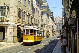 Typical yellow tram on the street in Lisbon, Portugal
