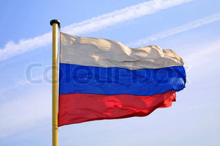 National flag of Russian Federation on blue sky background