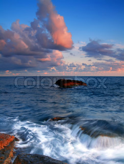 Colorful sunset on the shores of tropical sea