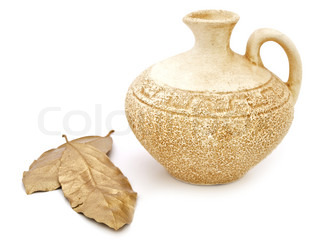 ancient beige vase and golden bay leaves against white background