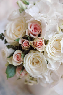 Wedding bouquet of white roses closeup. Small depth of field