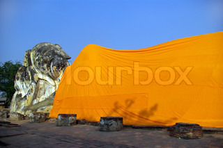 Giant statue of reclining Buddha covered with orange material at Ayutthaya, Thailand