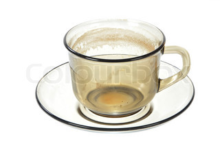 Dirty transparent coffee cup on saucer on white background