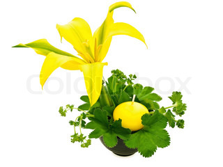 green bouquet with yellow lily and candle over white background