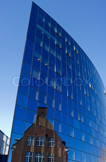 Futuristic public hospital building with reflection of old hospital building.