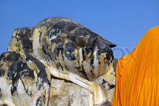 Giant statue of reclining Buddha covered with orange material at Ayutthaya? Thailand