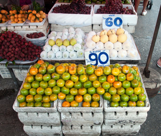fruit market in bangkok Thailand with mangos and apples