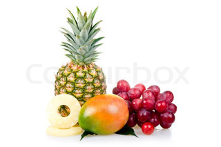Pineapple with slices, mango and grapes isolated on white background (still life)