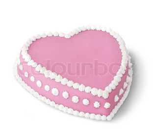 Pink heart shape marzipan cake decorated with white whipped cream