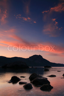 Colorful sunrise in a quiet ocean cove
