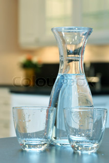 Water in a bottle and two glasses