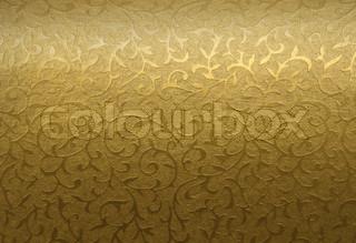 Golden brocade fabric floral texture background