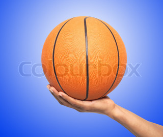 Basketball in hand over blue background