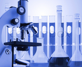 Laboratory metal microscope and test tubes with liquid toning in blue color