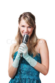 Pretty young girl singing into retro microphone, isolated on white