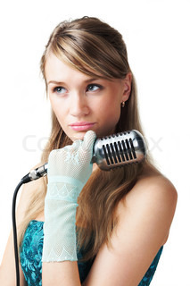 Pretty young girl holding retro microphone, isolated on white