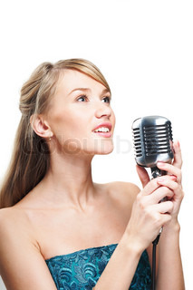 Pretty young girl singing into retro microphone, on white