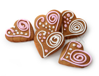 Heart shape ginger breads decorated with pink and white sugar glazi