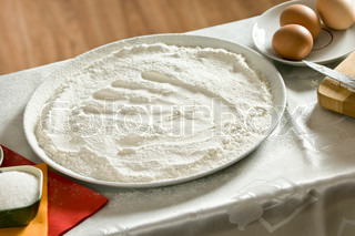 imprint of a woman's hand in a bowl with the flour