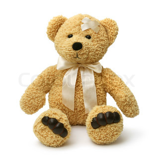 Injured teddy bear sitting sad on white background isolated