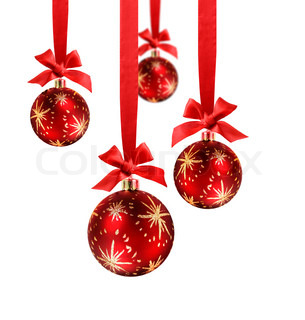 Decorated red christmas balls hanging in red silk ribbons with know and bow