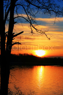 Colorful sunset on the river in early spring