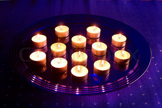 Small Christmas candles on glass tray