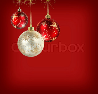 Decorated red and white christmas balls on vivid crimson red background
