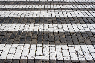 Cobblestone road background with white lines