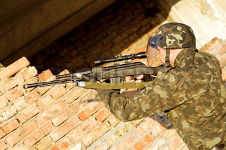 Soldier assaulting near the red brick wall